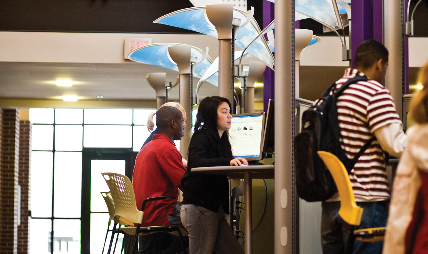 Students in the Andover Student Union working at computers